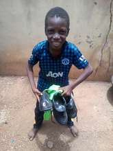 Boy with donated cleats