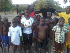 Ducie Village 1st youth soccer team with new ball