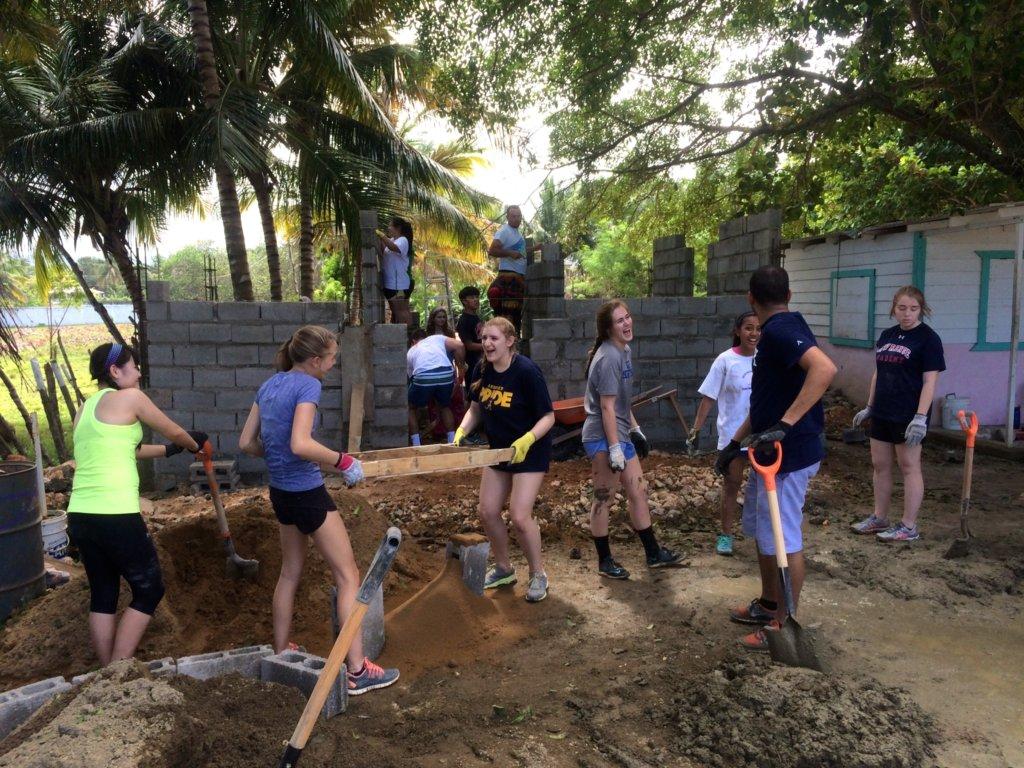 Volunteers having fun and working hard!