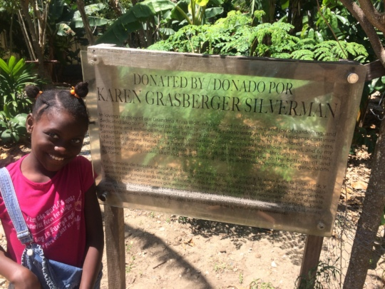 Dayana proudly stands at our Mama Tingo garden.