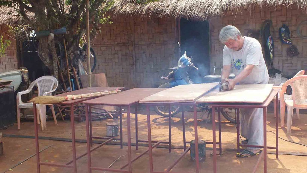 The camp head man showing off his carpentry skills