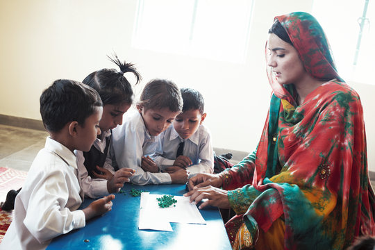 A DIL teacher works with her students