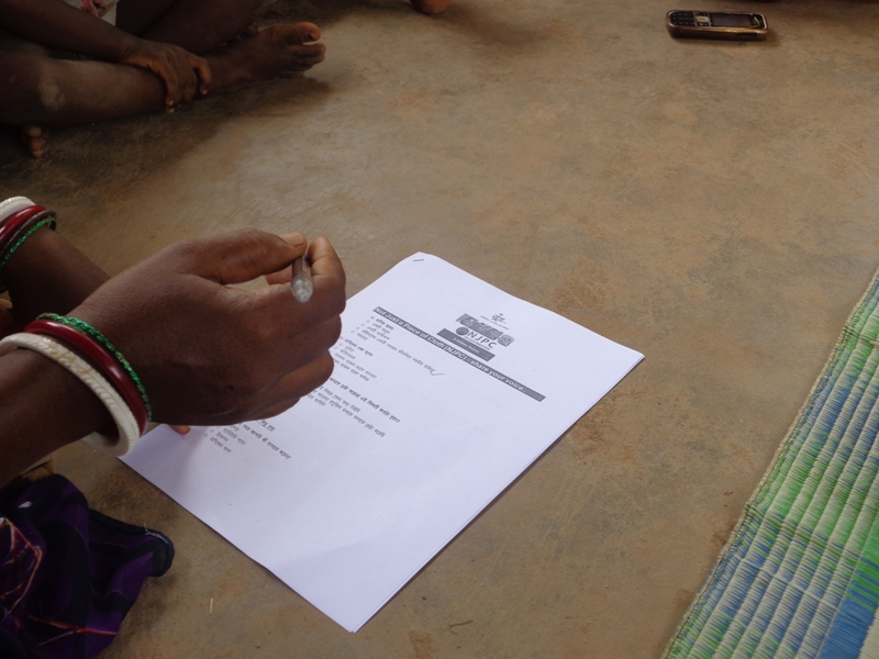 A lady filling out the survey form
