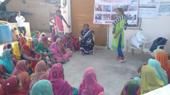 Women being educated to make their own cloth pad