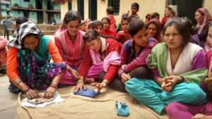 Women learning to make 'MY Pad'