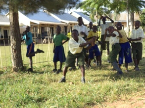 Pupils cleaning up their school compound
