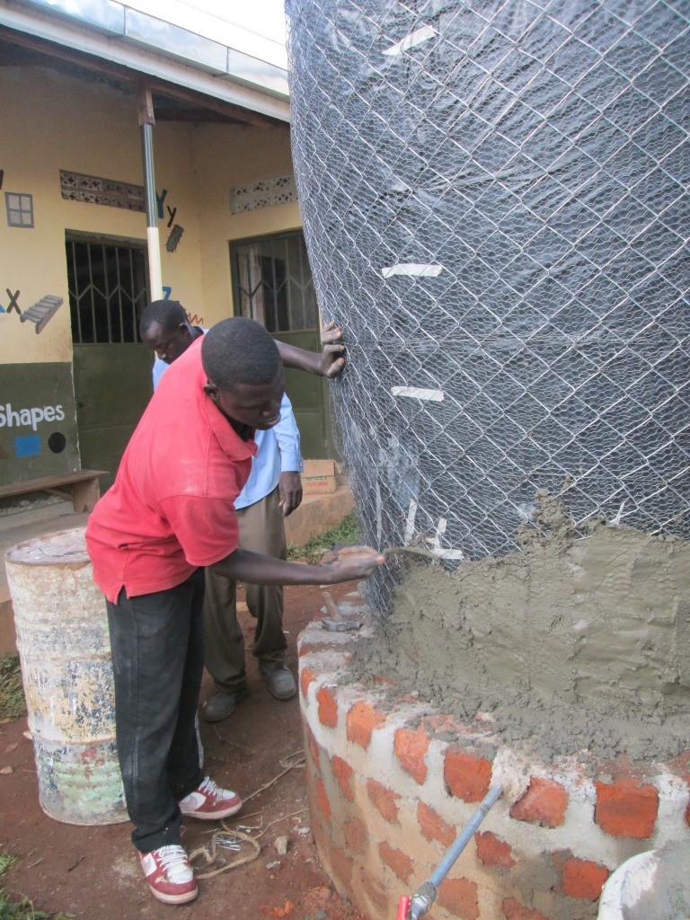 Plastering the wire meshed wood form