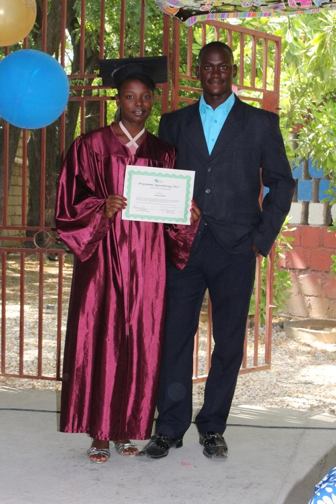 Djemson and Jonise with graduation certificate