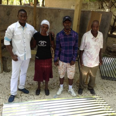 Kenold and his Family Receiving Tin Roofing