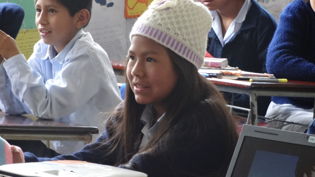 Carla in classroom listening atentively