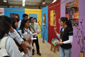 A volunteer presenting the poster