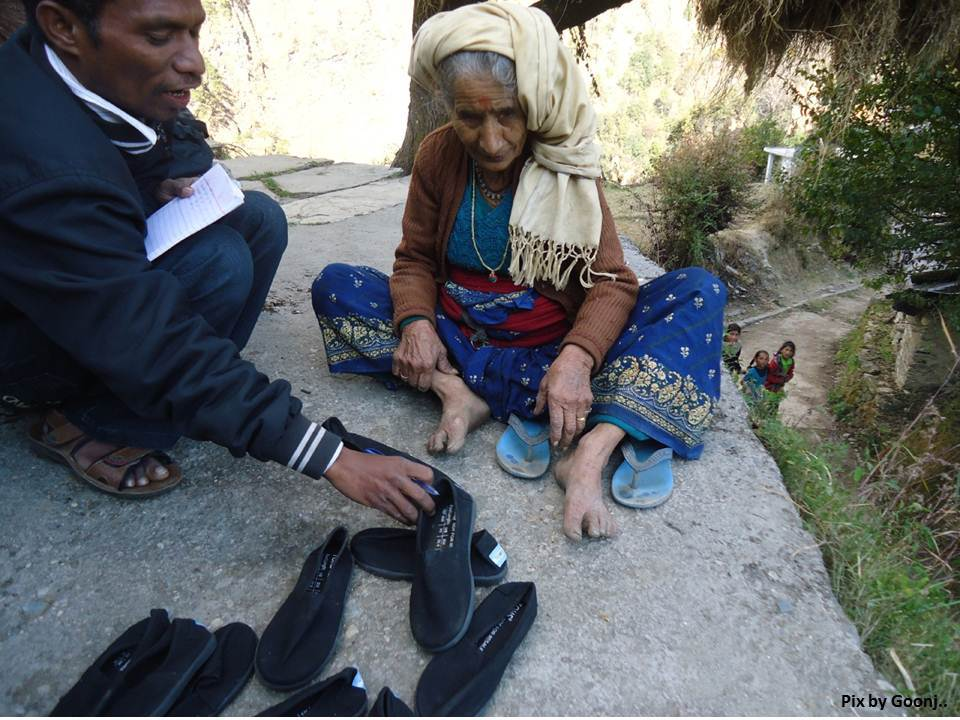 An old lady trying on the smart shoes!