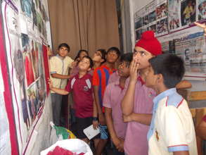 Children learning about the work of Goonj
