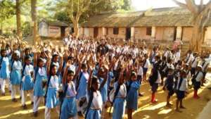 Children excited with school kits..