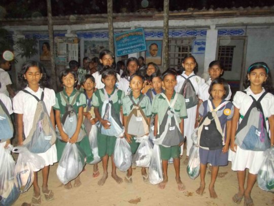 Children happy to use the school kit.