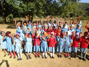 Girl children with the school kits