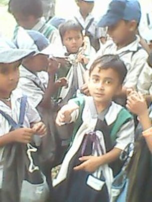 Girl child with her school kit..