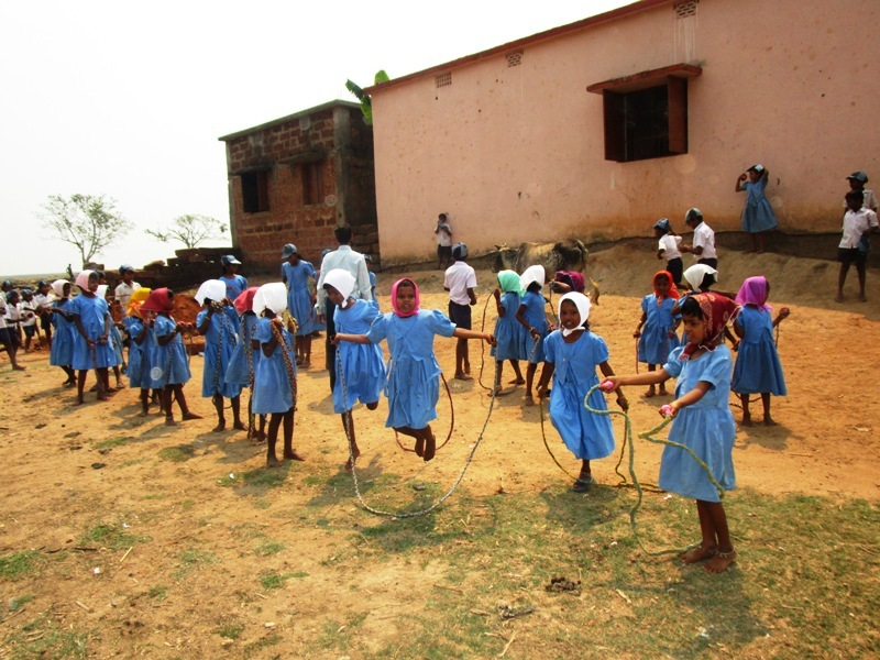 Girl children skipping to their heart