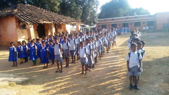 Children happy to get their school kits