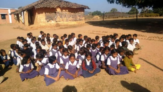 Children excited to get their school kits