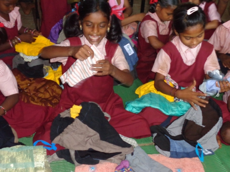 Girls excited with their School Kits!