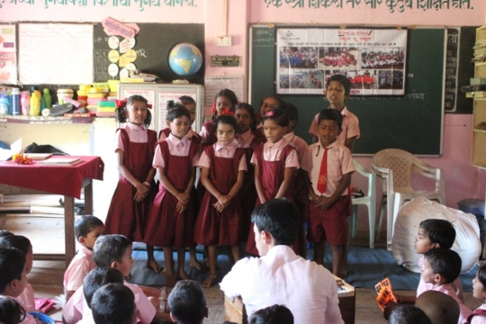 Children singing a group song..