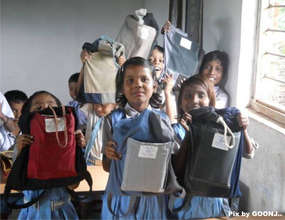 Showing their school kits...