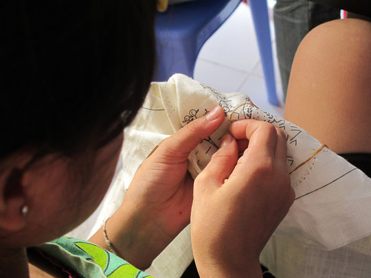 Concentrating deeply in the intricate needle work