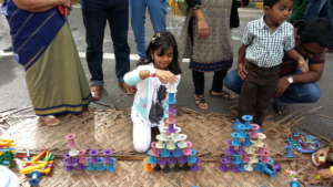 A child building the tower blocks