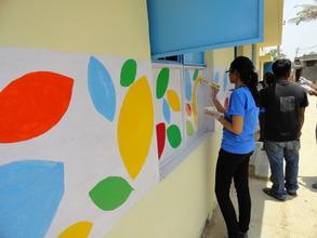 Corporate volunteers paint the signature BL design