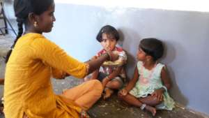 Mother feeding children