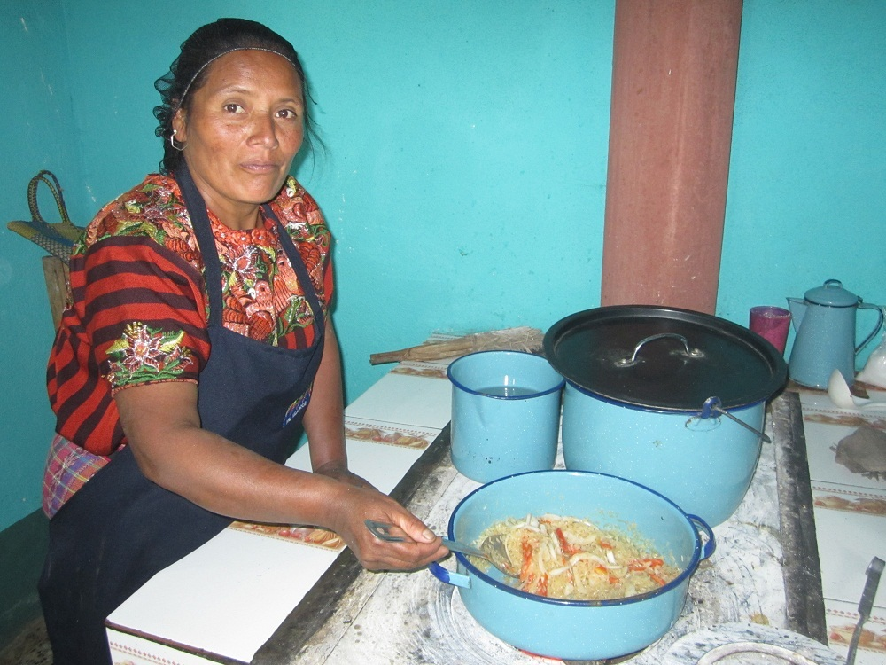 Dona Andrea cooking for the students