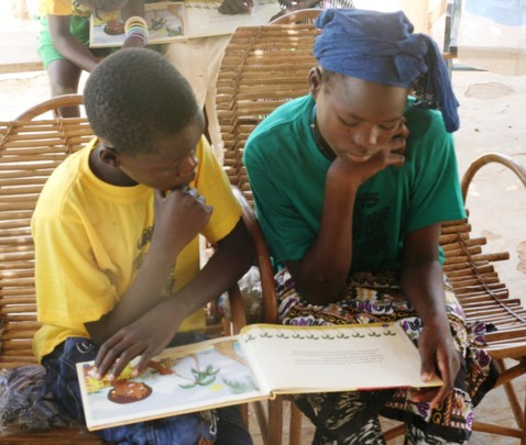 Kids reading Fatou Keita book