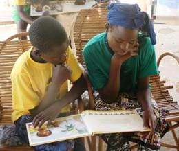 Kids reading Fatou Keita book