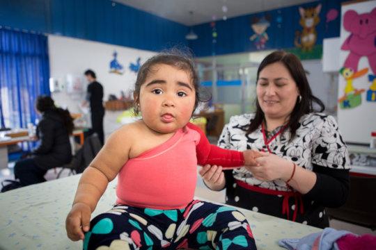 A  tiny patient receives compression garments!