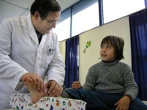Dr Jorge Rojas treats a burned child at COANIQUEM