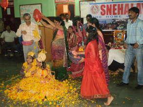Playing Holi with flowers on Janmashtami