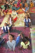 girls participating in yoga class in our school