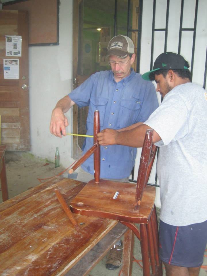 Fixing chairs - senior student and volunteer