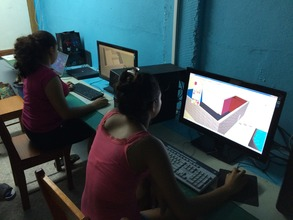 Girls learning to make 3-D building designs