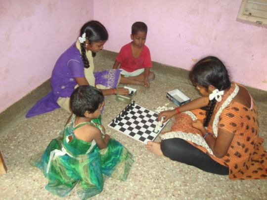 Rekha playing chess