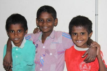 Anbarasan (centre) with friends in New Life
