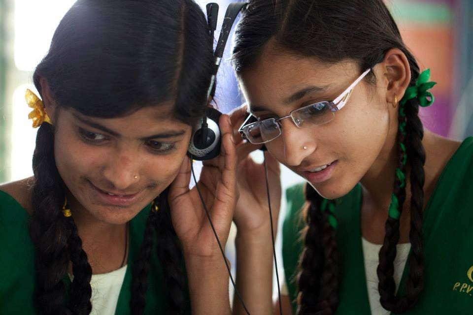 Manisha (right), topped 12th grade with 74.4%