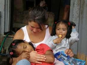 BWAB Costa Rica volunteer Cata Mora embraces girl