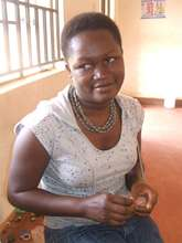 A survivor with her handmade jewelry