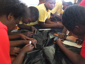 Learning how to make reusable menstrual pads.