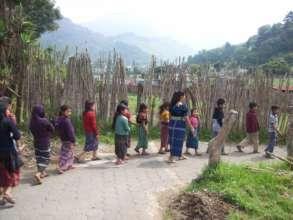 Children and teachers hiking in Guatemala