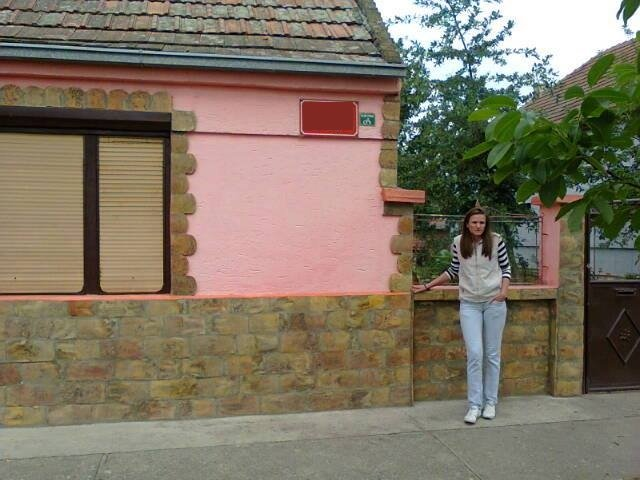 Aleksandra in front of her new house
