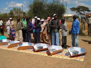 Community members witness solar cooking