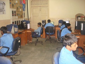 Children learning to use a computer